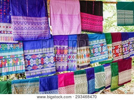 Traditional thai and Laos Sarong asian colorful on clothes line / woven silk shop poster