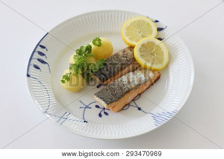 Grilled Salmon Fish Filets On A Plate With Potatoes, Parley And Slices Of Lemon. Close Up Stock Phot