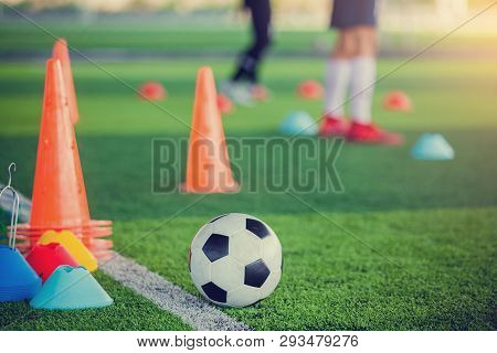Football And Soccer Training Equipment On Green Artificial Turf