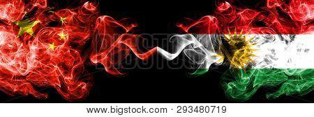 China Vs Kurdistan, Kurdish Smoke Flags Placed Side By Side. Thick Colored Silky Smoke Flags Of Chin