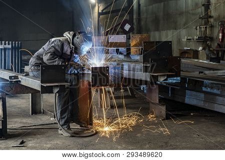Welding With Sparks By Process Fluxed Cored Arc Welding , Industrial Steel Welder Part In Factory We