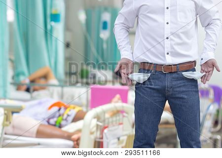Man Showing His Empty Pockets, Concept Of Money Spent On Medical Bills.