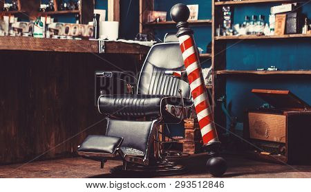 Barber Shop Pole. Logo Of The Barbershop, Symbol. Stylish Vintage Barber Chair. Hairstylist In Barbe