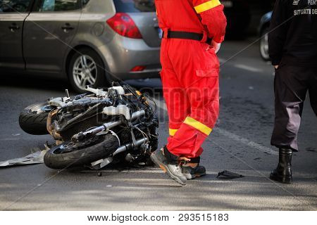 Police And Paramedics At The Site Of A Car And Motorcycle Road Accident