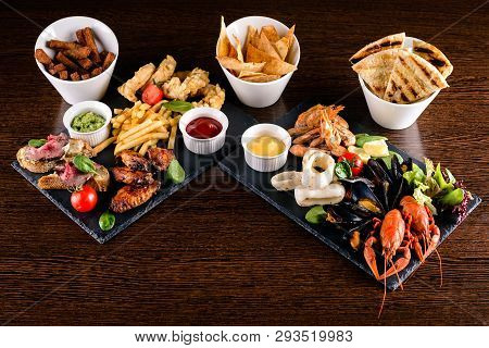 Set Of Seafood: Red And Black Caviar, Limb Of Hairy Crab, Seafood Platter. Mediterranean Cuisine Res