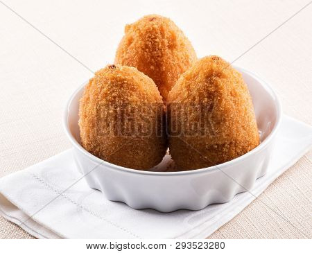 Three Deep Fried Arancini From Sicily In A Bowl