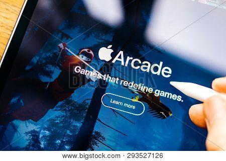 Paris, France - Mar 27, 2019: New Apple Arcade Logotype Seen On Modern Ipad Pro Tablet Featuring The