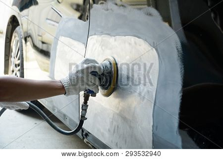 Mechanic Worker Repairman Fixing By Sanding Polishing Car Body And Preparing For Painting At Station