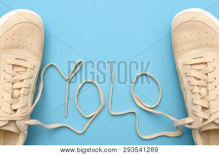 Women Sneakers With Laces In Yolo Abbreviation Text.