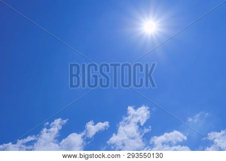 Strong Sun And Skies, Clear Sky Background With Tiny Clouds.