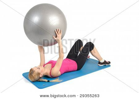 Female lying abs crunching exercise with fitness ball. position 1 of 2.