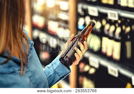 Customer Buying Beer In Liquor Store. Lager, Craft Or Wheat Beer. Ipa Or Pale Ale. Woman At Alcohol