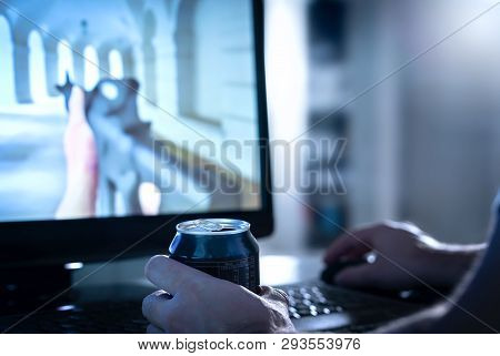 Guy Streaming Or Watching Video Game Live Stream Online While Drinking Energy Drink Or Soda From Can