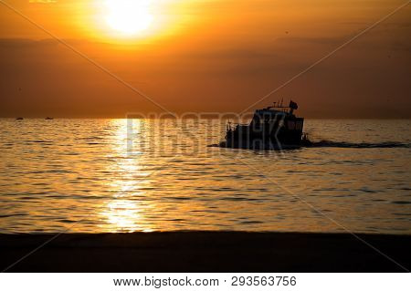 Silhouette Of A Boat Sailing On The Marmara Sea At Striking Sunset.