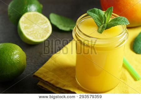 Mango Lime Smoothie Refreshing Tropical Drink Front View Close Up Of A Glass Jar With Mint Leaves An