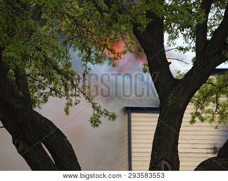 A Blast Of Flames Flares Up From A Large Condo Fire. The Units Were A Total Loss.