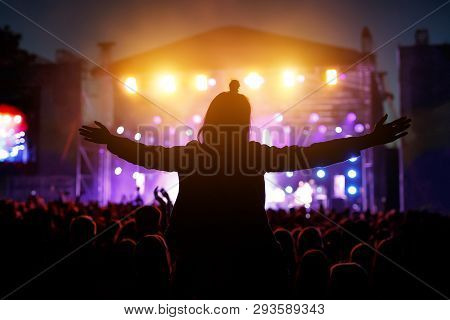 Girls With Hands Up Dancing, Singing And Listening The Music During Concert Show On Summer Music Fes