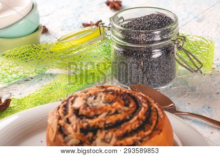 Glass Jar With Sealed Cover Full Of Raw Poppy Seeds On Light Board