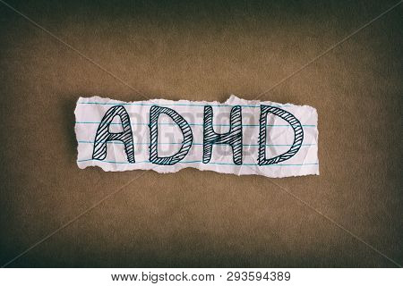 Adhd. Abbreviation Adhd On Brown Background. Close Up. Adhd Is Attention Deficit Hyperactivity Disor