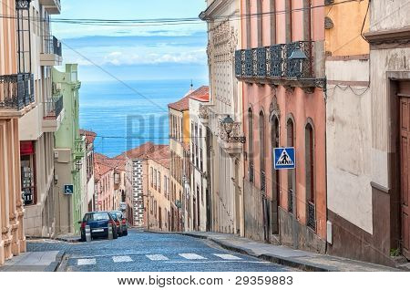 Street in spanish city with view to the sea, La Orotava, Canary islands, Spain