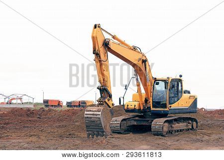 Crawler excavator at a construction site. Building. Excavator. Close poster
