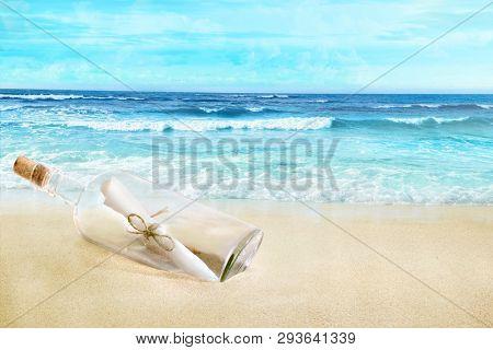 A bottle with a letter inside. Sandy beach.