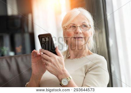 Portrait Of Elegant Senior Woman With Smart Phone. Lifestyle Photo Of Pension Woman.