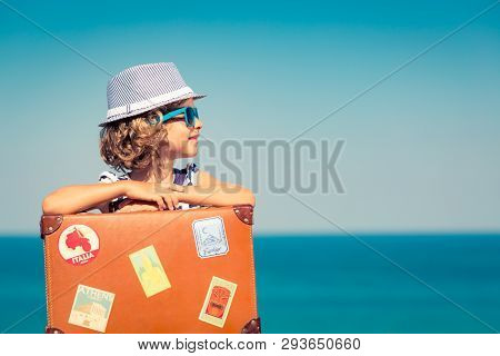 Child Enjoys A Summer Vacation At The Sea