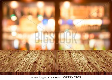Empty Wooden Table Top With Blurred Of Coffee Shop, Cafe, Bar Background, Abstract Background Can Be
