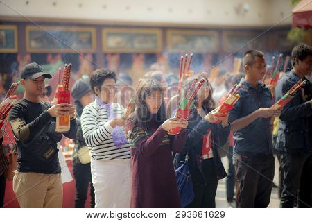 Hongkong China - March16,2019 : Large Number Of Asian People Praying To Buddhist Shrine With Incense