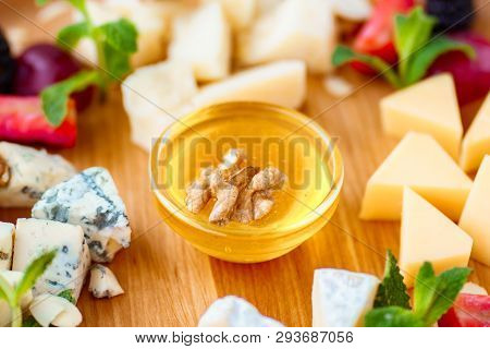Tasty Appetizer. Plate Of Cheese. Banquet, Restaurant Menu. Slices Of Various Cheeses. Camembert, Pa