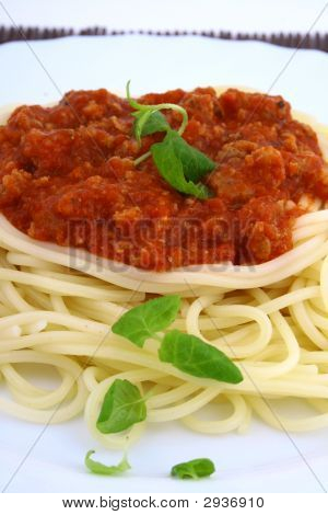 Freshly Cooked Plate Of Spaghetti With Fresh Green Herbs.