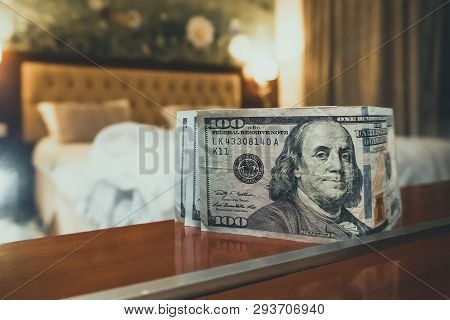 Room Tip. Bed And Money To Symbolize The Cost Of Sex. Paid Love The Prostitute. Payment For The Serv