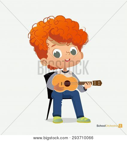 Curly Red-haired Boy Sit On Chair Play Guitar