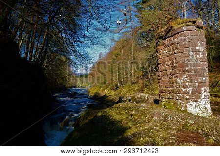A View Of An Old Ruined Bridge Above The Rocks Of Solitude In Glen Esk, Angus