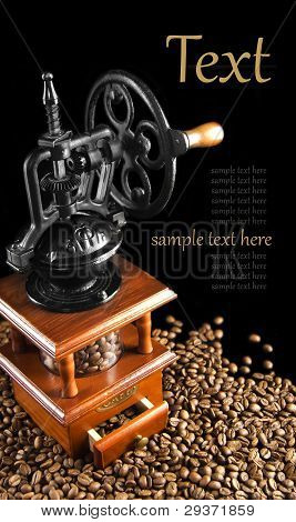 mechanical coffee grinder and grain Coffey on a black background poster