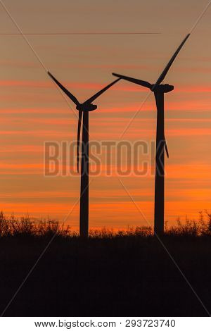Wind Turbines At Dusk. Landscape Sunset With Windmills. Renewal Source Of Electricity. Wind Turbines