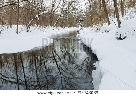 Winter Scenery With Fresh Fallen Snow Along Creek In Minnehaha Parkway Of Minneapolis Minnesota