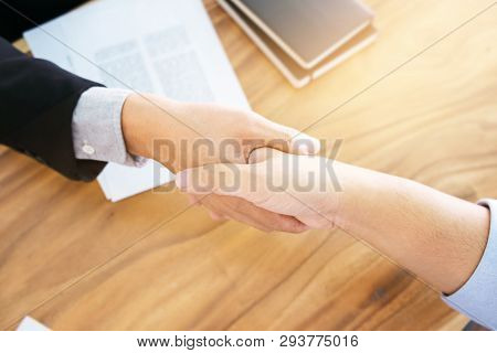 Real Estate Agent With Customer Making Contract Deal Signature And Analyzing Valuation