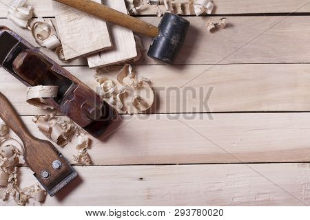 Construction Tools On Wooden Table With Sawdust. Joinery Carpenter Workplace Top View. Copy Space Fo