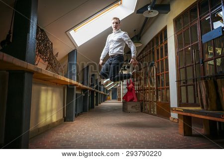 Happy Businessman Jump In The Office After Successfull Deal