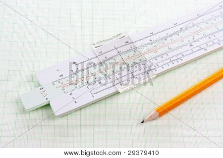 Slide Rule On Squared Paper With Wooden Pencil