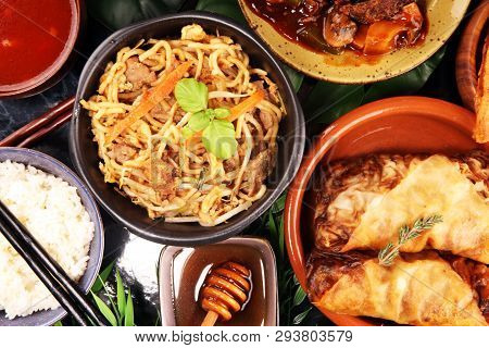 Assorted Chinese food set. Chinese noodles, fried rice, peking duck, dim sum, spring rolls. Famous Chinese cuisine dishes on table. Chinese restaurant concept. poster