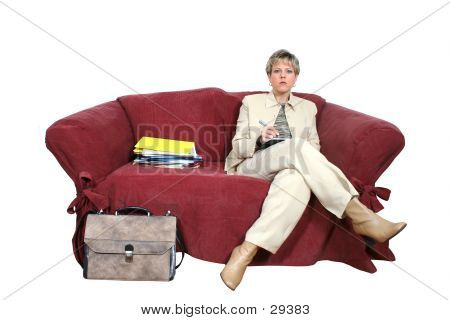 Business Woman Working On Couch Looking Up