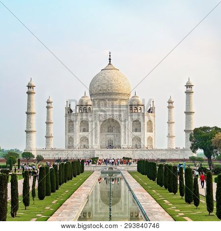 Taj Mahal Front View Reflected On The Reflection Pool, An Ivory-white Marble Mausoleum On The South