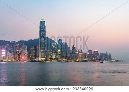 Hong Kong Skyline On The Evening Seen From Kowloon, Hong Kong, China.