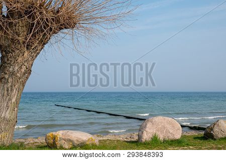 Long Groynes Protrude Into The Water Of The Blue Baltic Sea