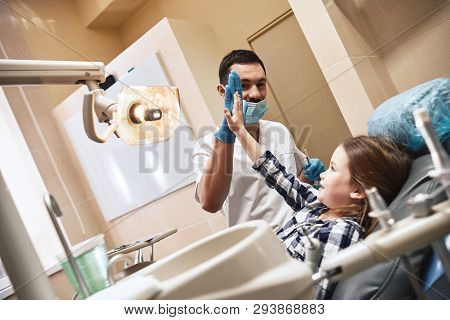 The Cure For Dental Anxiety. Kid At The Dental Office. A Child Is Happy After Dental Treatment And G