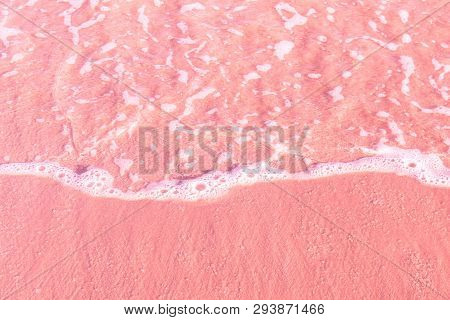 Foamy Clear Sea Wave Rolling To Pink Sand Shore Beach. Aerial View From Above. Beautiful Tranquil Id