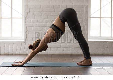 Woman Practicing Yoga, Downward Facing Dog, Adho Mukha Svanasana
